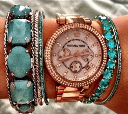 Michael Kors watch paired with simple bracelets