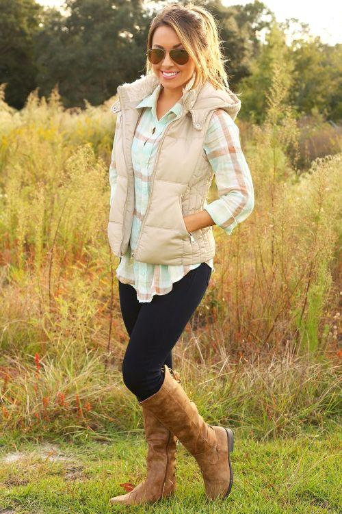 beige puffer vest with shirt outfit