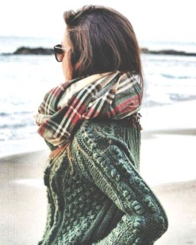 green sweater and scarf