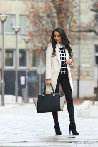 white coat with black sweater