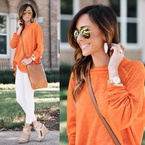 orange sweater with white pants
