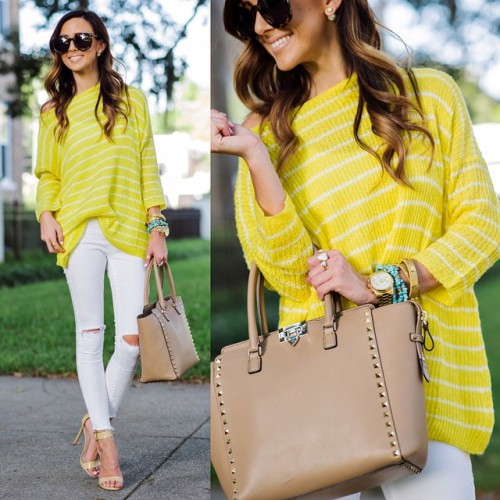 yellow sweater with white pants