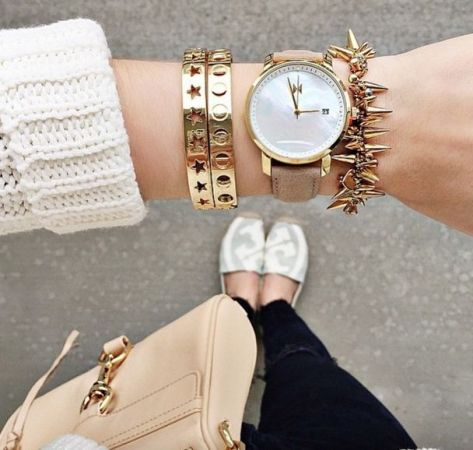 white sweater with stacking bracelets
