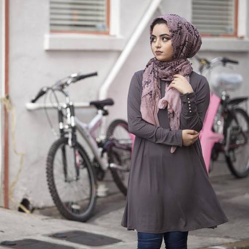 modest top in grey