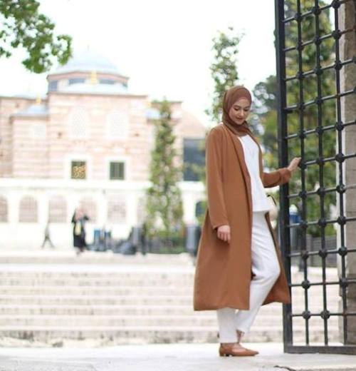 tan coat with white outfit