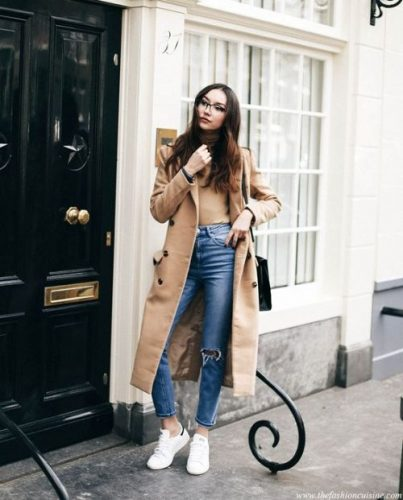 tan coat with white sneakers