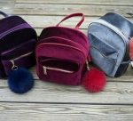 Velvet and leather backpacks